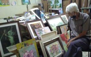 Le peintre au milieu de ses oeuvres